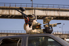 Paintball players on the car Stock Photography