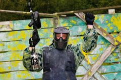 Paintball players in full gear Stock Photo