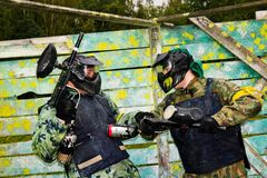 Paintball players in full gear Royalty Free Stock Image