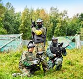 Paintball players in full gear stock image
