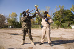 Paintball players with gold cup. Paintball players with guns and gold cup royalty free stock photo
