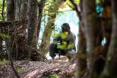 Paintball Players Hide Behind Tree Royalty Free Stock Images