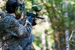 Paintball Players Hide Behind Tree Royalty Free Stock Photos