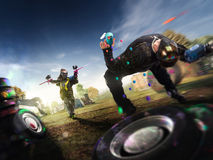 Paintball players are playing the game
