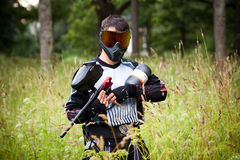 Paintball shooter in the field Stock Images