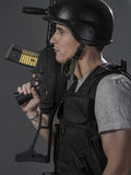 Paintball sport player wearing protective helmet aiming pistol , Royalty Free Stock Photo