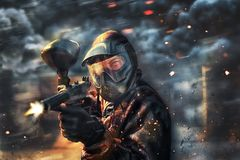 Paintball sport player wearing protective mask. Shooting Royalty Free Stock Photo