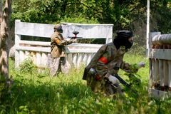 Paintball sport players. Go to attack Stock Images