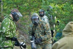 Paintball sport players during a game Stock Photo