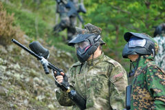 Paintball sport players during a game Stock Images