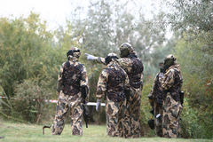 Paintball team. The commander of the team pointing the purpose Stock Photo