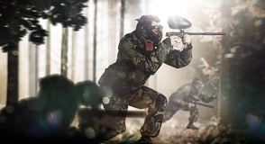 Paintball team in action forest location. Day light Stock Photo
