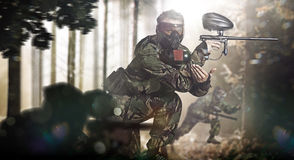 Paintball team in action forest location Royalty Free Stock Photos