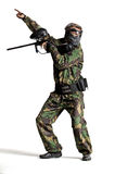 Paintball team in action forest location Royalty Free Stock Photo