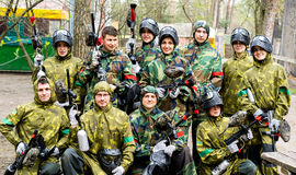 Paintball team with guns end equipment Stock Images