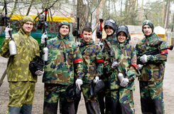 Paintball team with guns end equipment Stock Photography