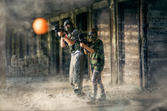 Paintball team together in action Royalty Free Stock Photos