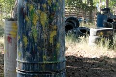 Paintball territory. Close-up of barrels of color blots from paintball gun shots. Old tires from the car as a shelter. Background. Close-up of barrels of color royalty free stock photos