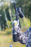 Paintball weapon in hand close up. Leisure activity concept. Stock Image
