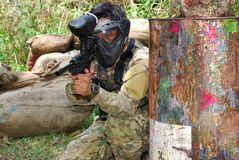 Paintball Woodsball. Ready to shoot action in the paintball field stock photo