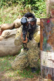 Paintball Woodsball. Ready to shoot action in the paintball field stock images