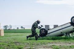 Paintballer running through battlefield. Paintballer running though battlefield , in camouflage cloths Stock Image