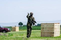 Paintballer running through battlefield. Paintballer running though battlefield , in camouflage cloths Royalty Free Stock Photo
