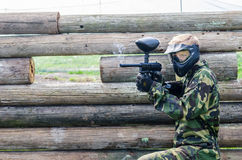 Paintballer shooting. Paintballers shooting, in camouflage cloths Royalty Free Stock Photography