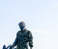 Paintballer standing in battlefield. In camouflage cloths Stock Images