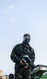 Paintballer standing in battlefield. In camouflage cloths Stock Photography