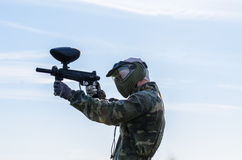 Paintballer standing in battlefield Stock Image