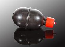 Paintballgranaat op weerspiegelende oppervlakte Royalty-vrije Stock Foto