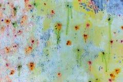 Paintballkulan färgar väggbakgrund Royaltyfria Foton