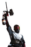 Paintballtireur, der eine Gewehr anhält lizenzfreies stockbild