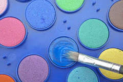 Paintbox. Water colors in a paint box with brush Stock Image