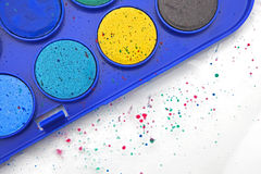 Paintbox. Paint box with water-colors and splashes of paint Stock Images