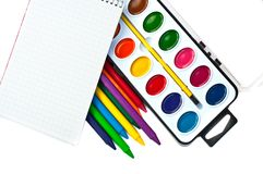 Paintbox, crayons and note book Royalty Free Stock Photography