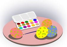 Paintbox and Easter eggs. Royalty Free Stock Photography