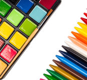 Paintbox, wax crayons. On the white Royalty Free Stock Photography
