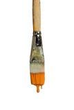 Paintbrush капая померанцовую краску Стоковая Фотография RF