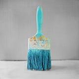 Paintbrush. Blue paintbrush on black and white background Royalty Free Stock Image