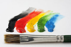 Paintbrush and 5 dabs of watercolor paint Royalty Free Stock Images