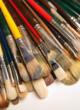 Paintbrush assortment. A bunch of used paintbrushes stock images