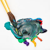 Paintbrush blends multicolored watercolors Stock Photography