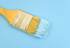 Paintbrush with blue paint Royalty Free Stock Images