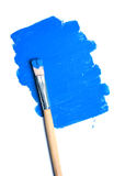 Paintbrush and blue paint spot isolated Royalty Free Stock Photo