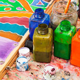 Paintbrush and bottles with dyes Royalty Free Stock Image