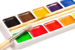 Paintbrush on box of dry aquarelle Stock Images