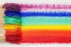Paintbrush bristle closeup and multicolor rainbow brush strokes Royalty Free Stock Photo