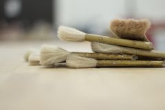 Paintbrush on a Brown Surface Photo Royalty Free Stock Images